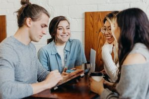 4 students discussing in a coworking space